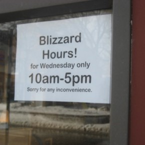 A sign on the door of Dusty Groove, a record store in Wicker Park. The toughest record store in the city. While the majority of offices shut down, Dusty Groove is apologizing for only being open seven hours.