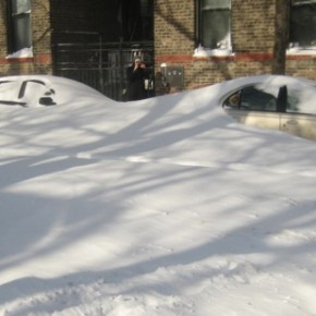An onlooker ponders if her Progressive car insurance will cover blizzard damage.